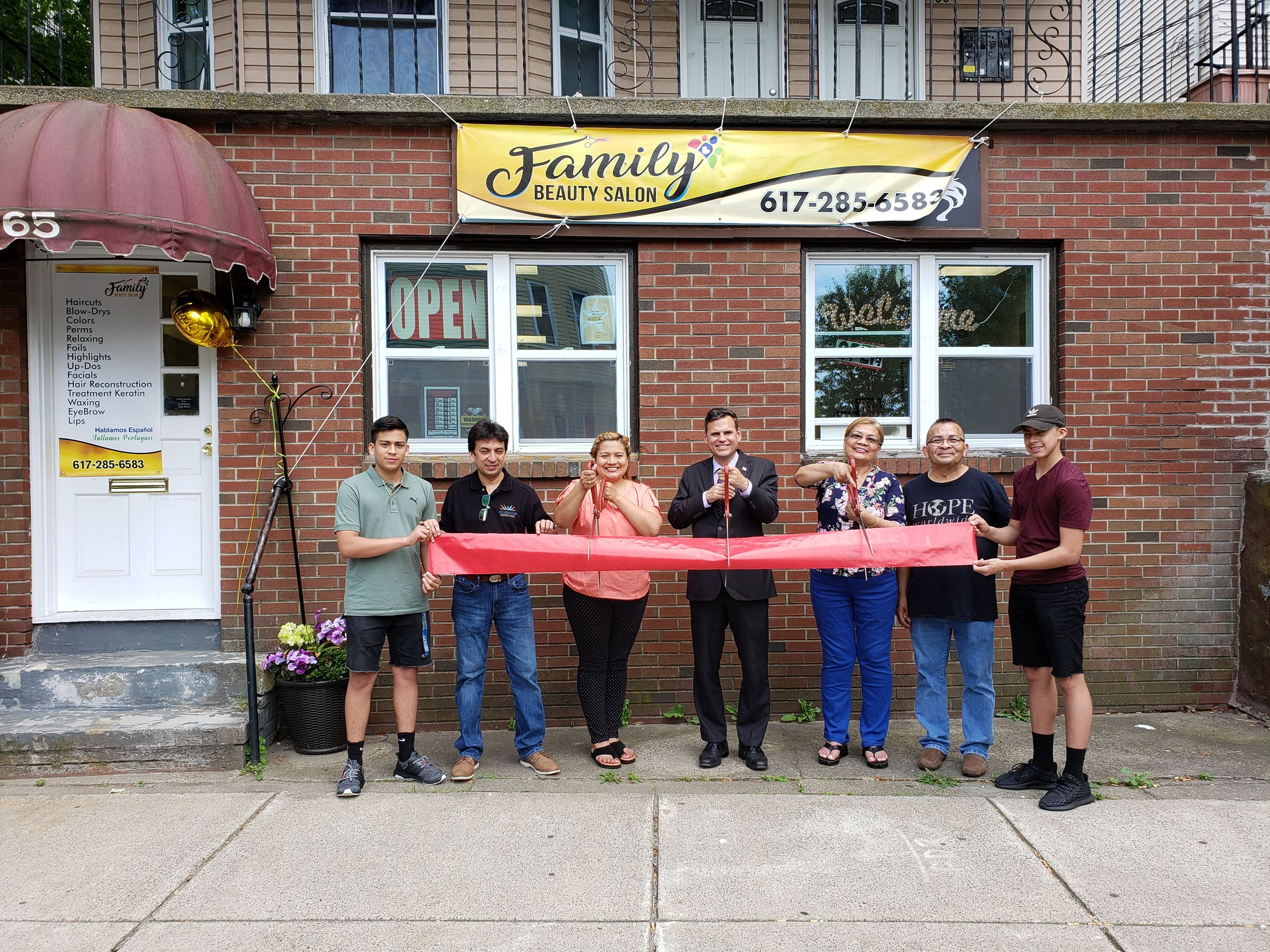 Family & friends celebrate the grand opening of Family Beauty with Owner (left of Mayor) Iris Monge