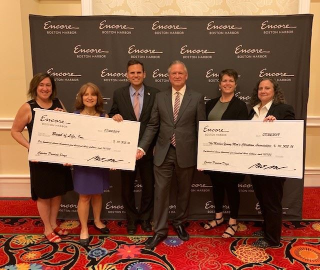 Mayor Christenson with recipients of Encore donation