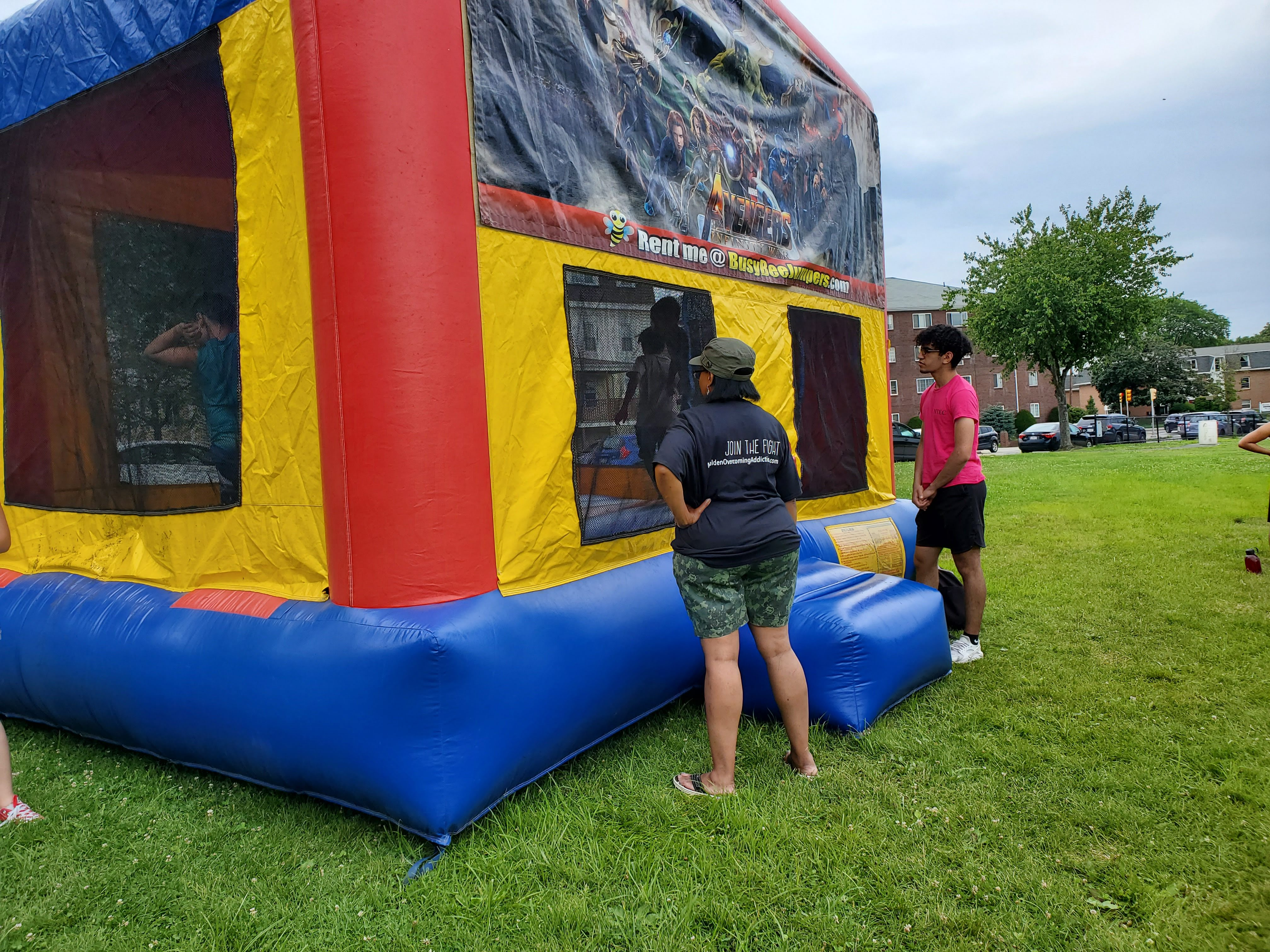 Teen watches over the Bouncy house to ensure Safety