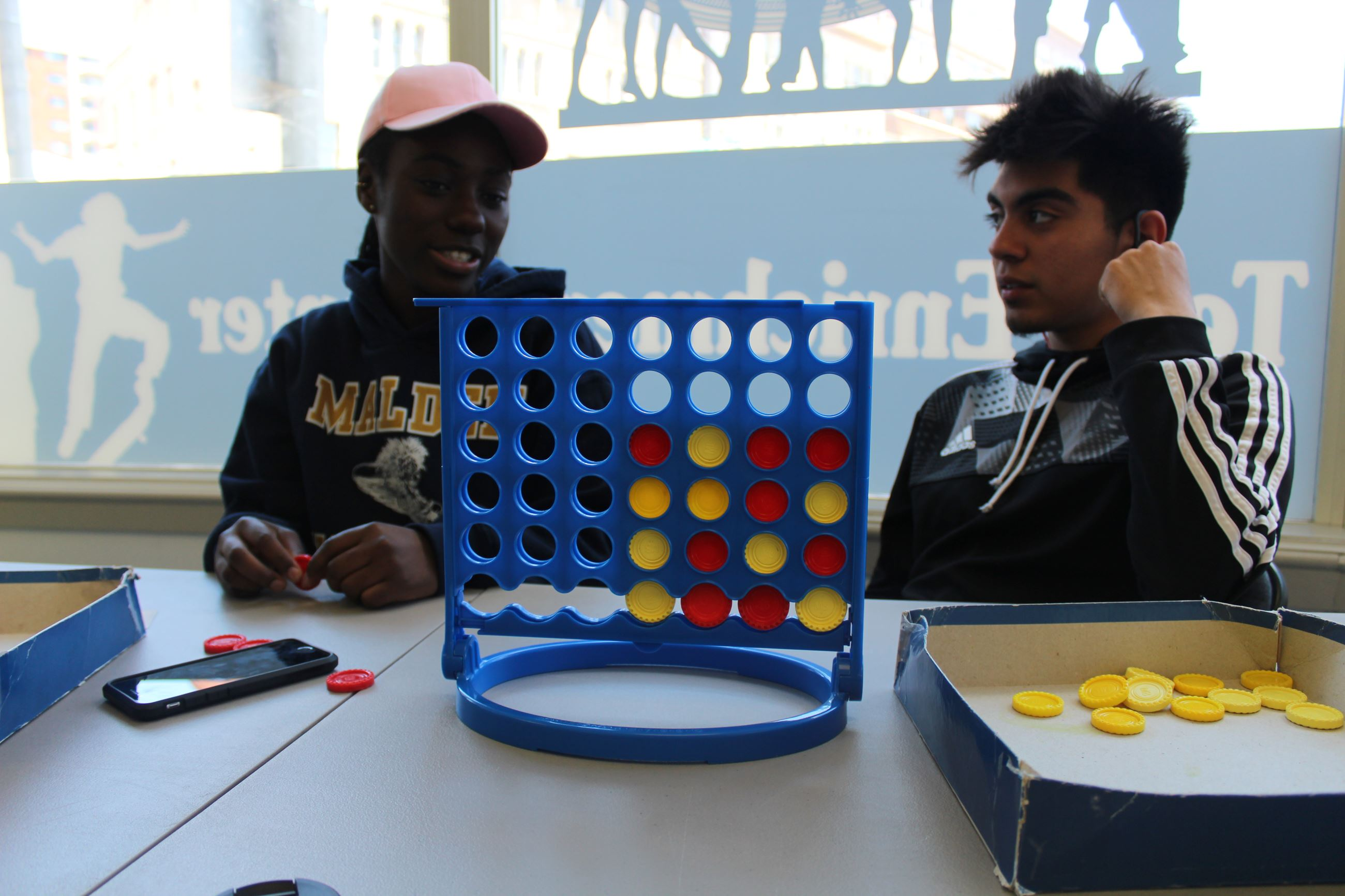 Teens Playing Connect 4