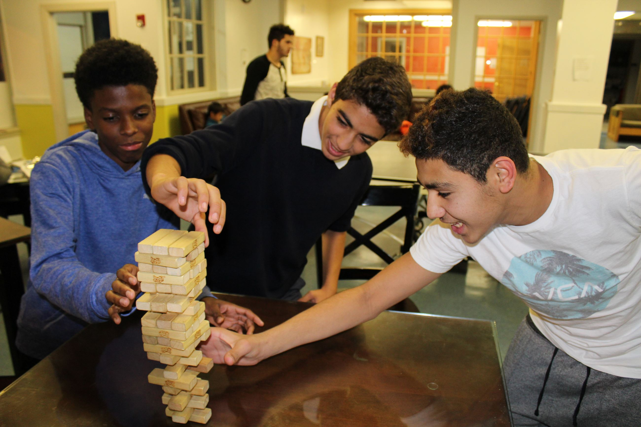 Teens playing Jenga