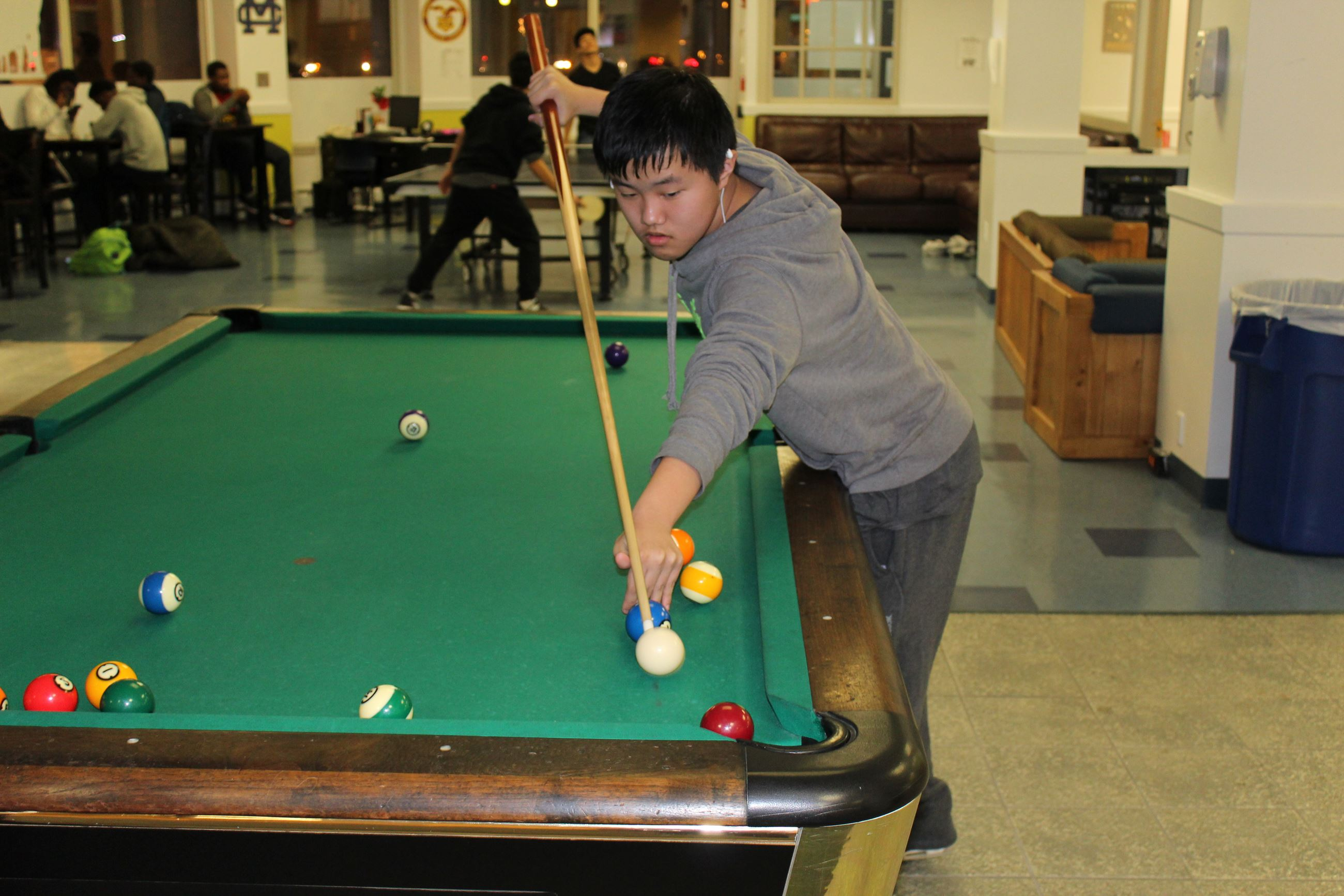 Teen Playing Pool