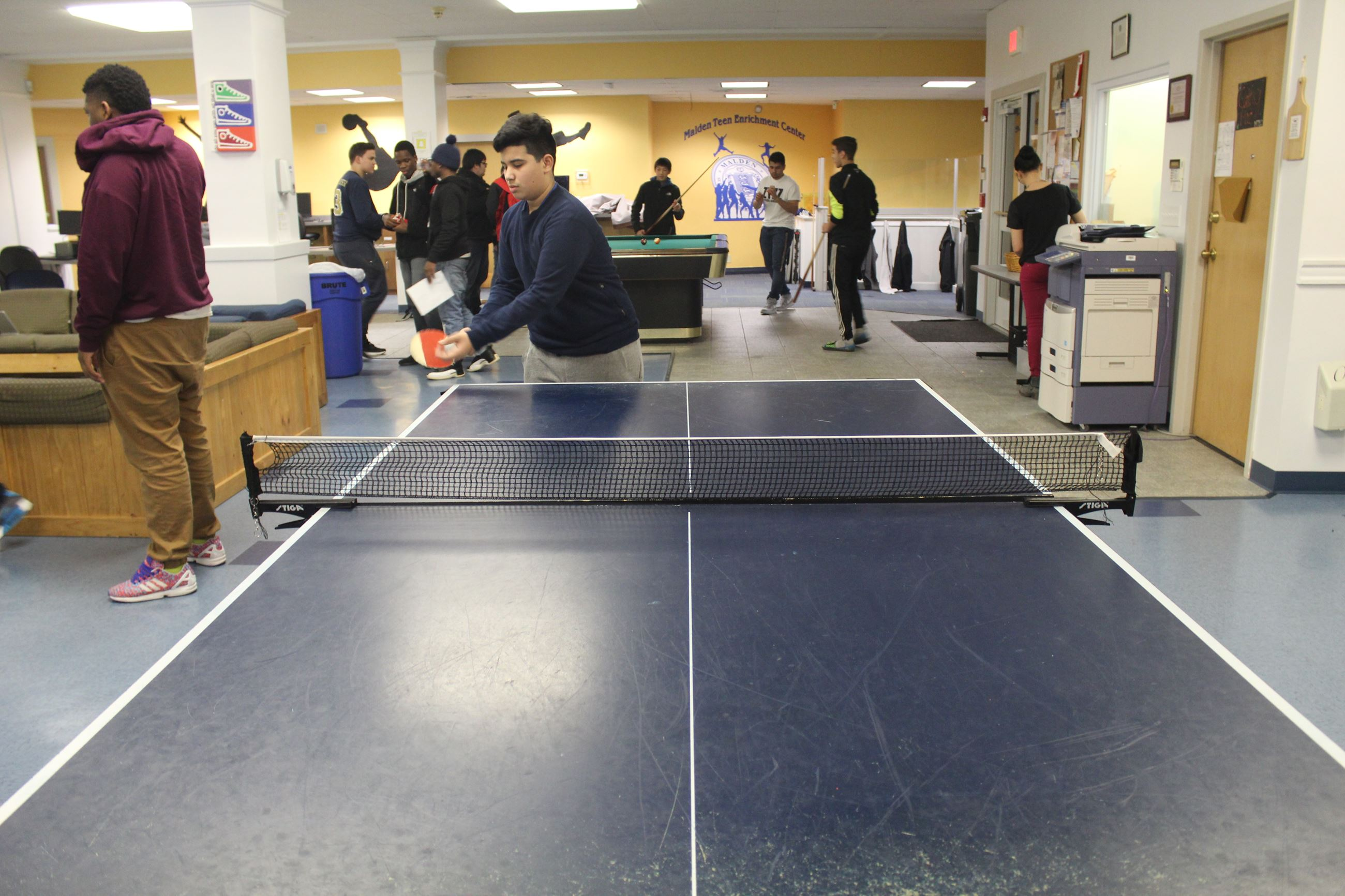 Teens Playing Ping Pong